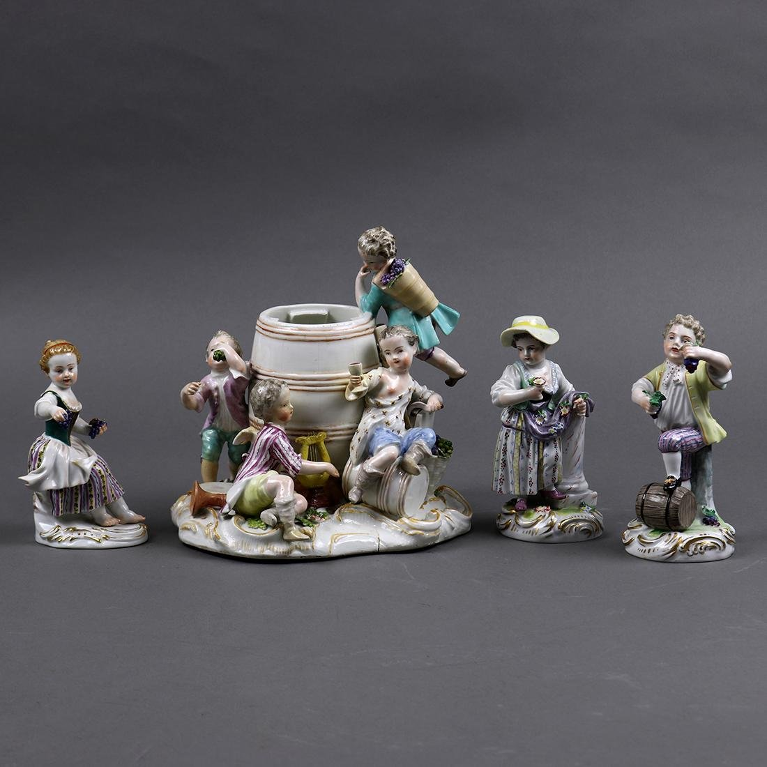 (lot of 4) Continental porcelain figural groups,