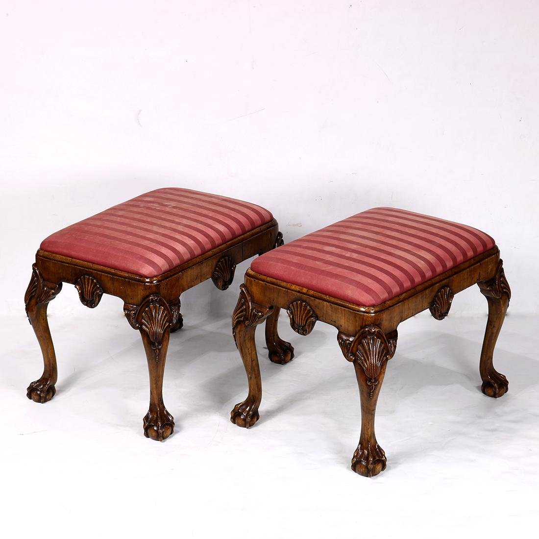 Pair of Chippendale style ottomans, having an