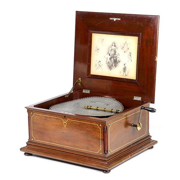(lot of 45) Regina music box, having an inlaid mahogany