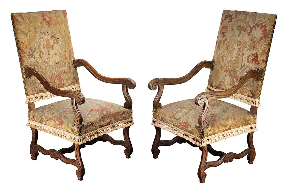 Pair of Continental carved fireside chairs