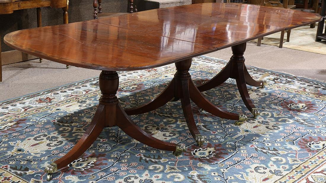 Regency style triple pedestal dining table, the top