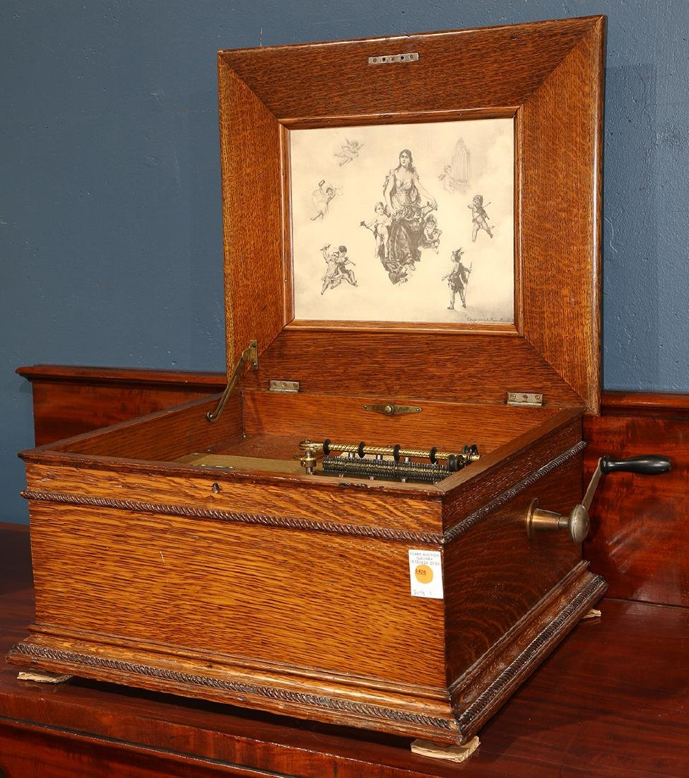 Victorian Regina music player, the oak case having a