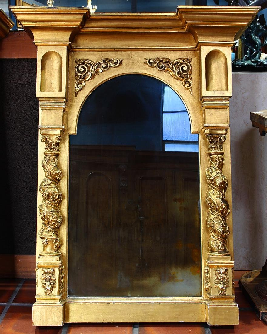 Renaissance style gilt looking glass