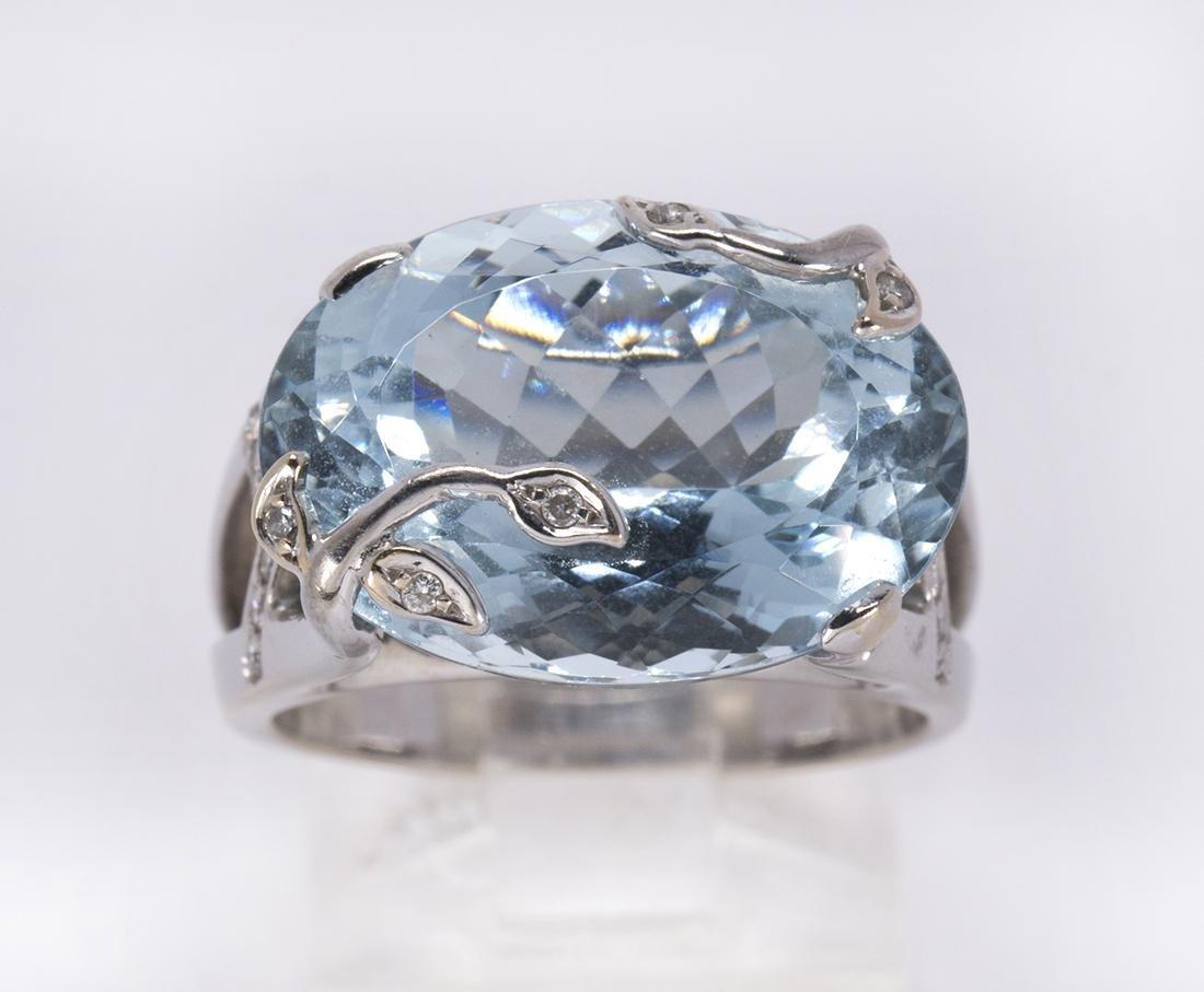 Aquamarine, diamond and 18k white gold ring