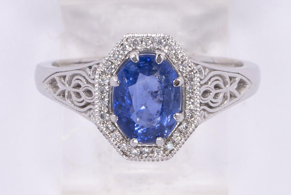 Sapphire, diamond and platinum ring