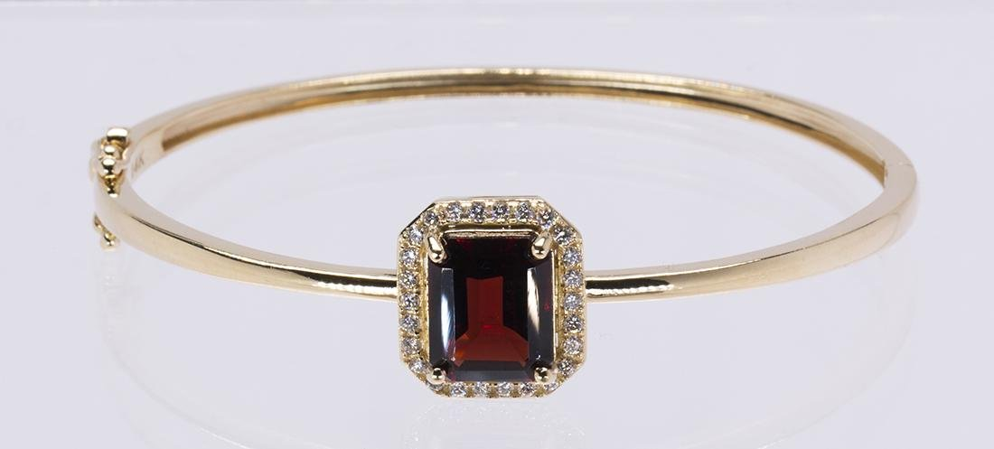 Garnet, diamond and 14k yellow gold bracelet