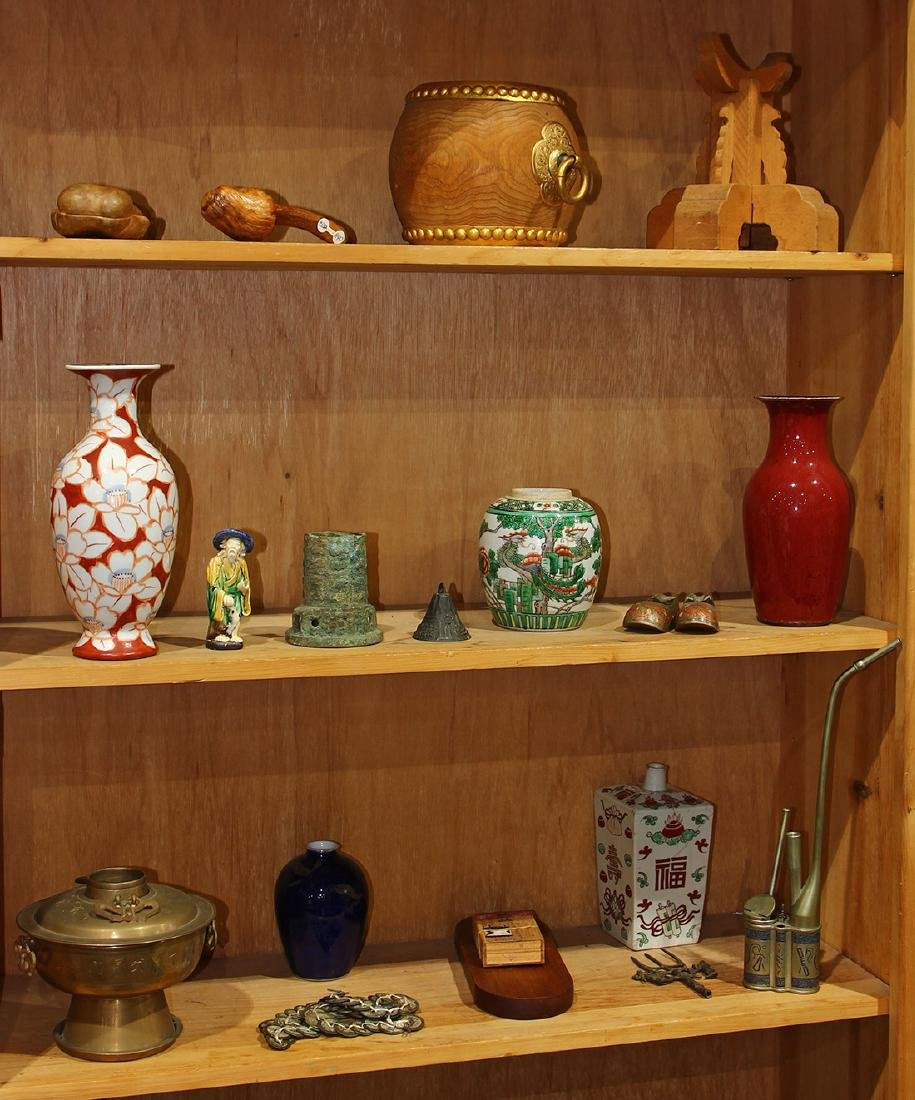Three Shelves of Asian Decorative Items