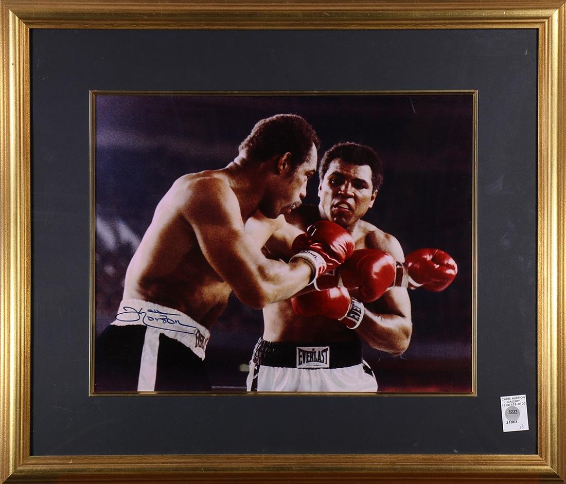 Framed photo relating to boxing legends Ken Norton and