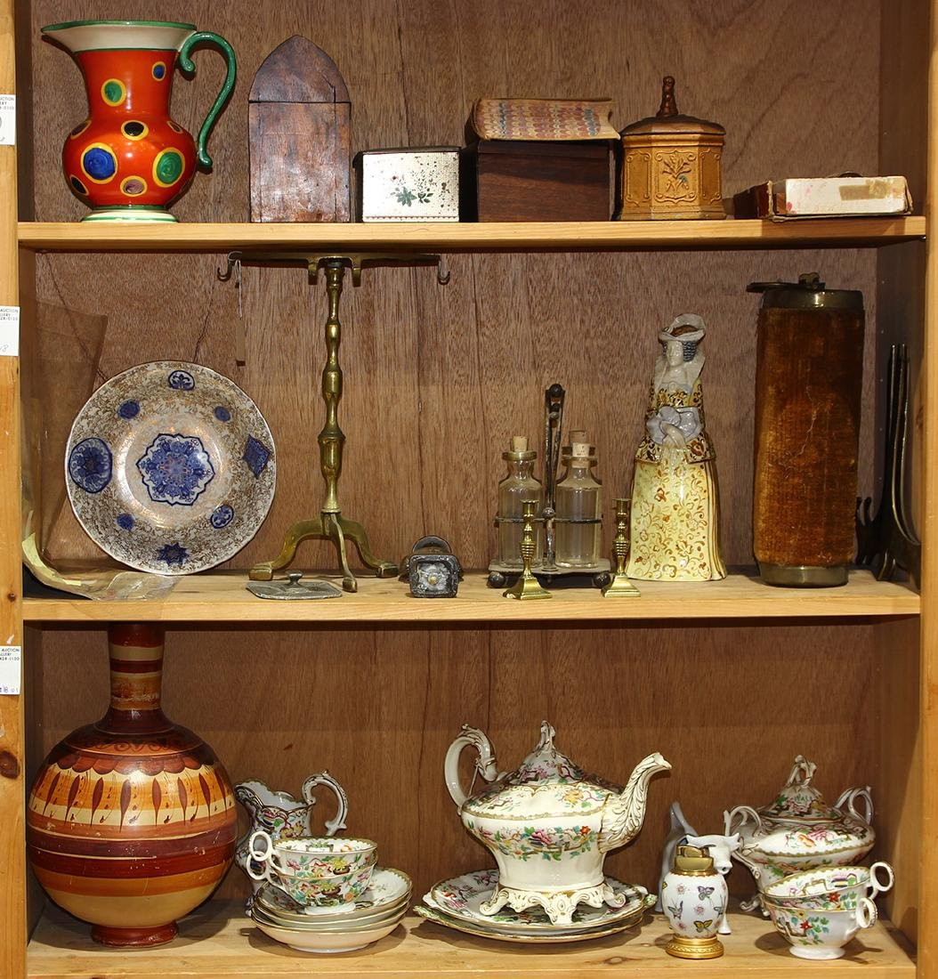 Three shelves of decorative art