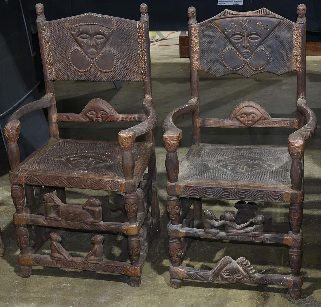 "(lot of 2) Pair of African carved wood armchairs, 42""h"