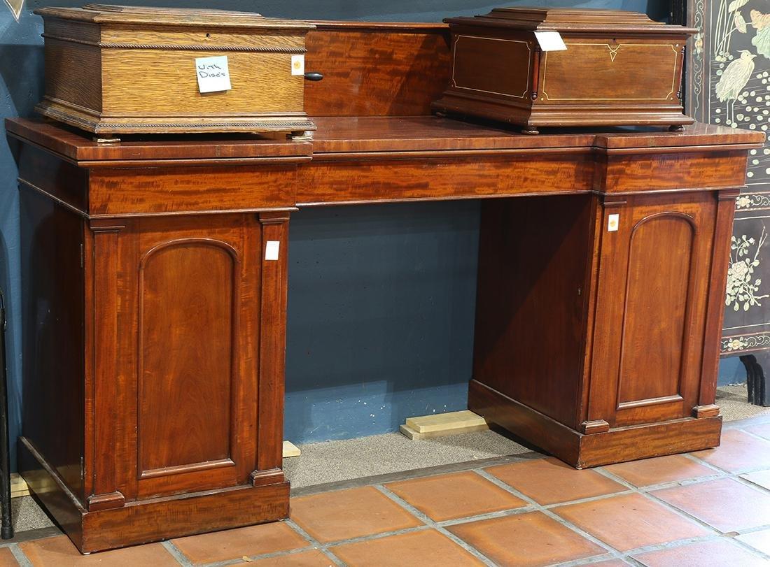 Regency mahogany sideboard, circa 1830, the shaped top