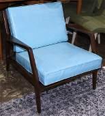 Mid-Century Modern armchair, having a blue upholstered