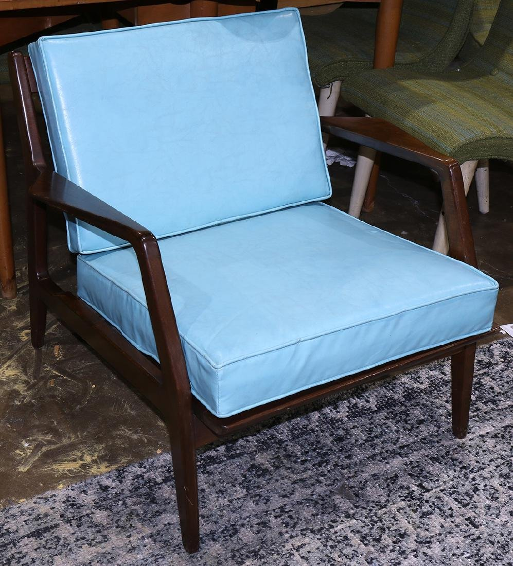 Mid-Century Modern armchair, having a blue upholstered