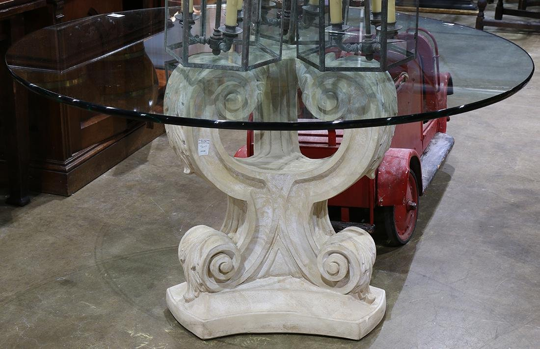 Modern center table, the glass round top above the