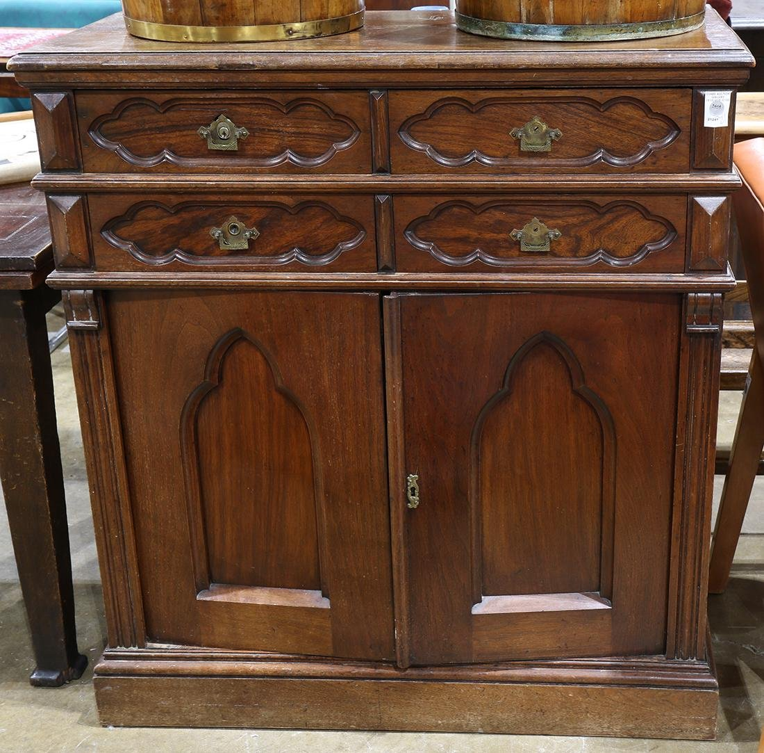 Gothic Revival chest, having a rectangular top, above