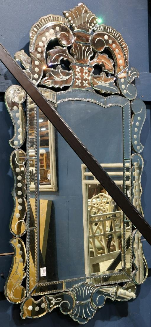 Venetian style wall mirror, having a scroll decorated