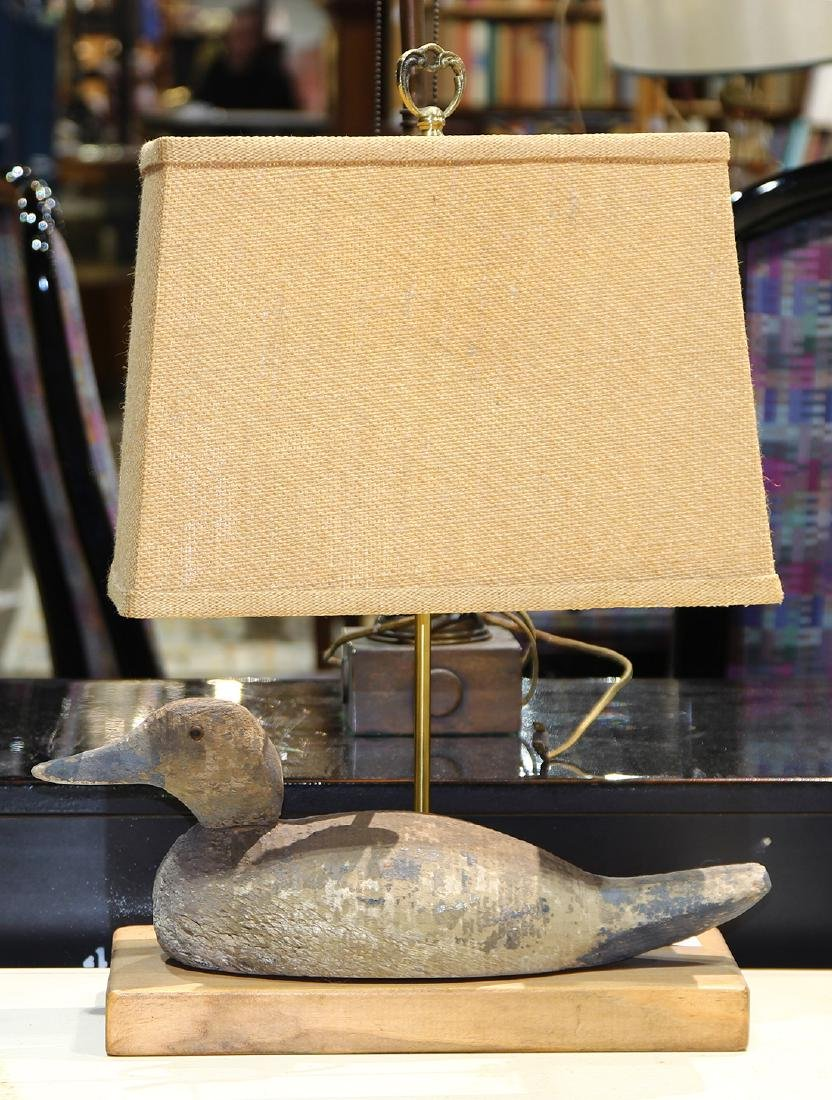 Duck decoy table lamp, the wood decoy mounted on a