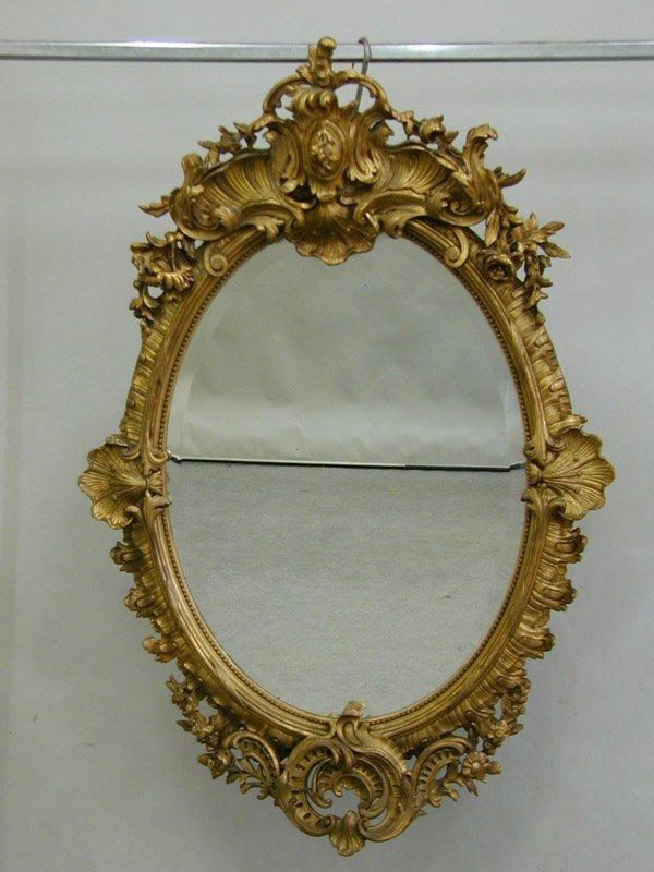 6521: Louis XV style gilt wood wall mirror