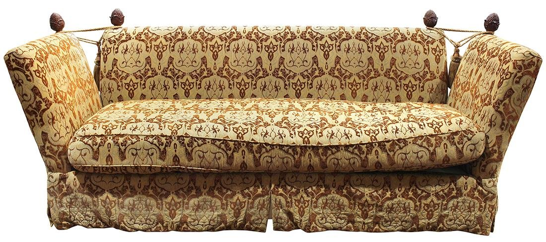 Knole sofa, the contoured profile upholstered in beige,