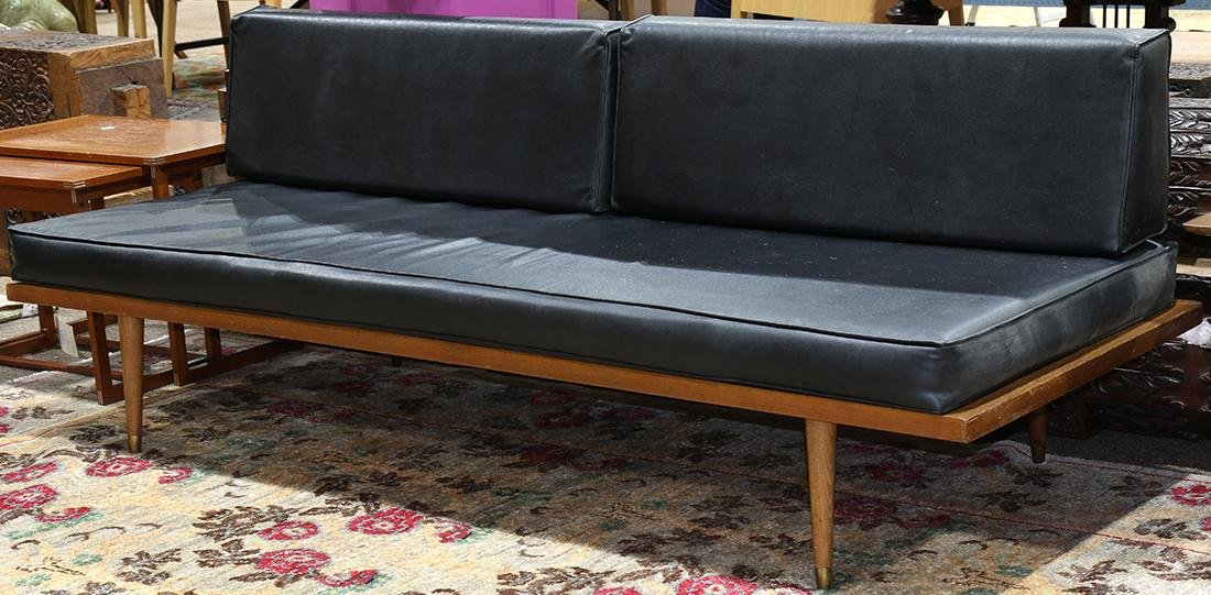 Modern Adrian Pearsell style sofa, having black
