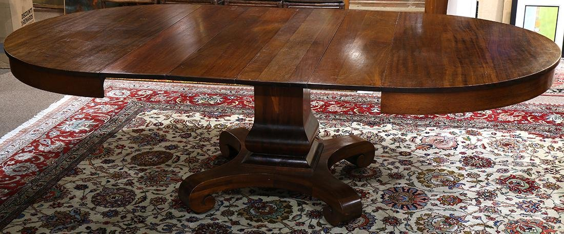 Empire style mahogany dining table, having four 10