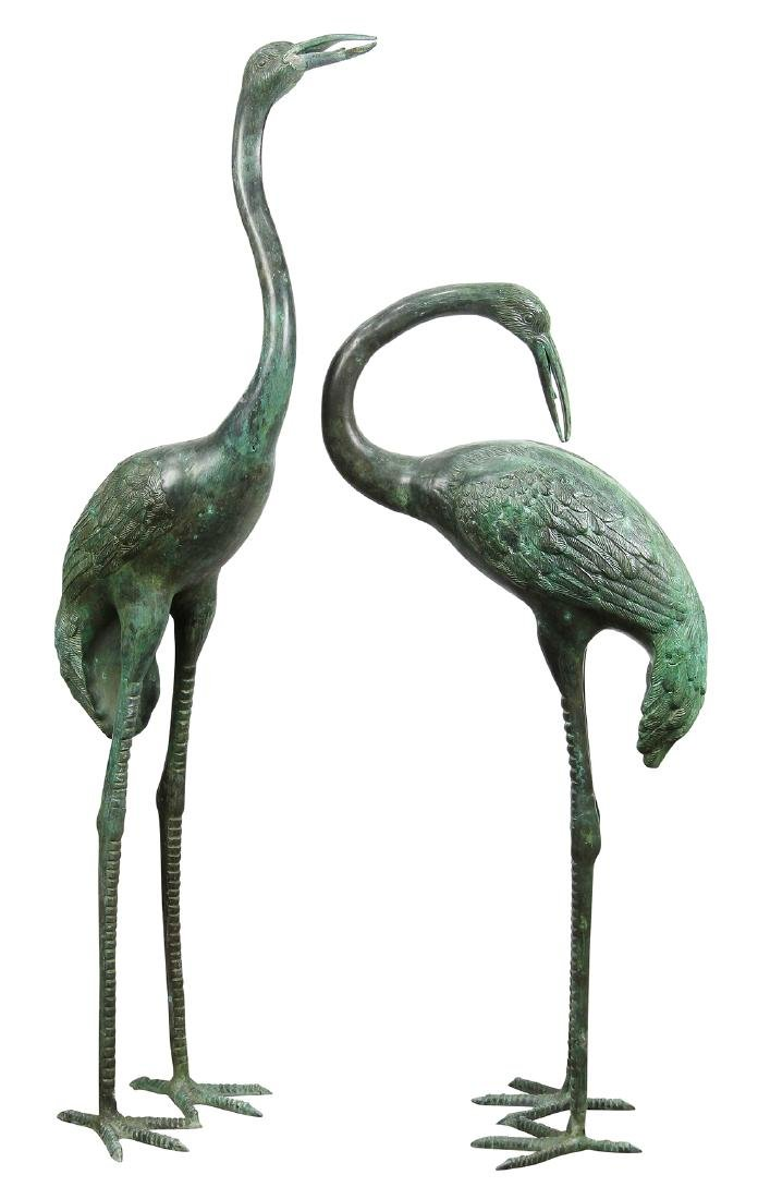 (lot of 2) Patinated bronze figural sculptures
