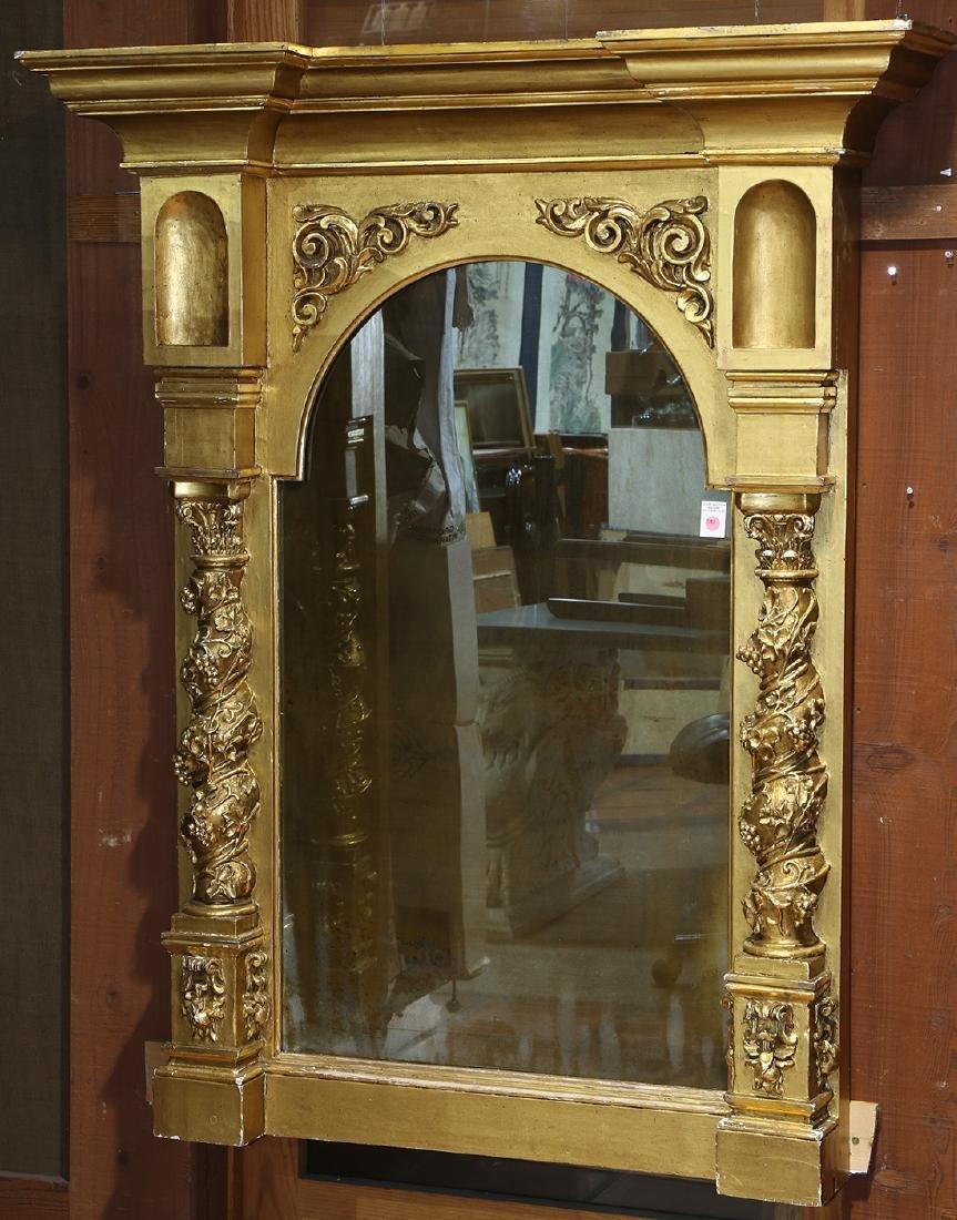 Renaissance style gilt looking glass