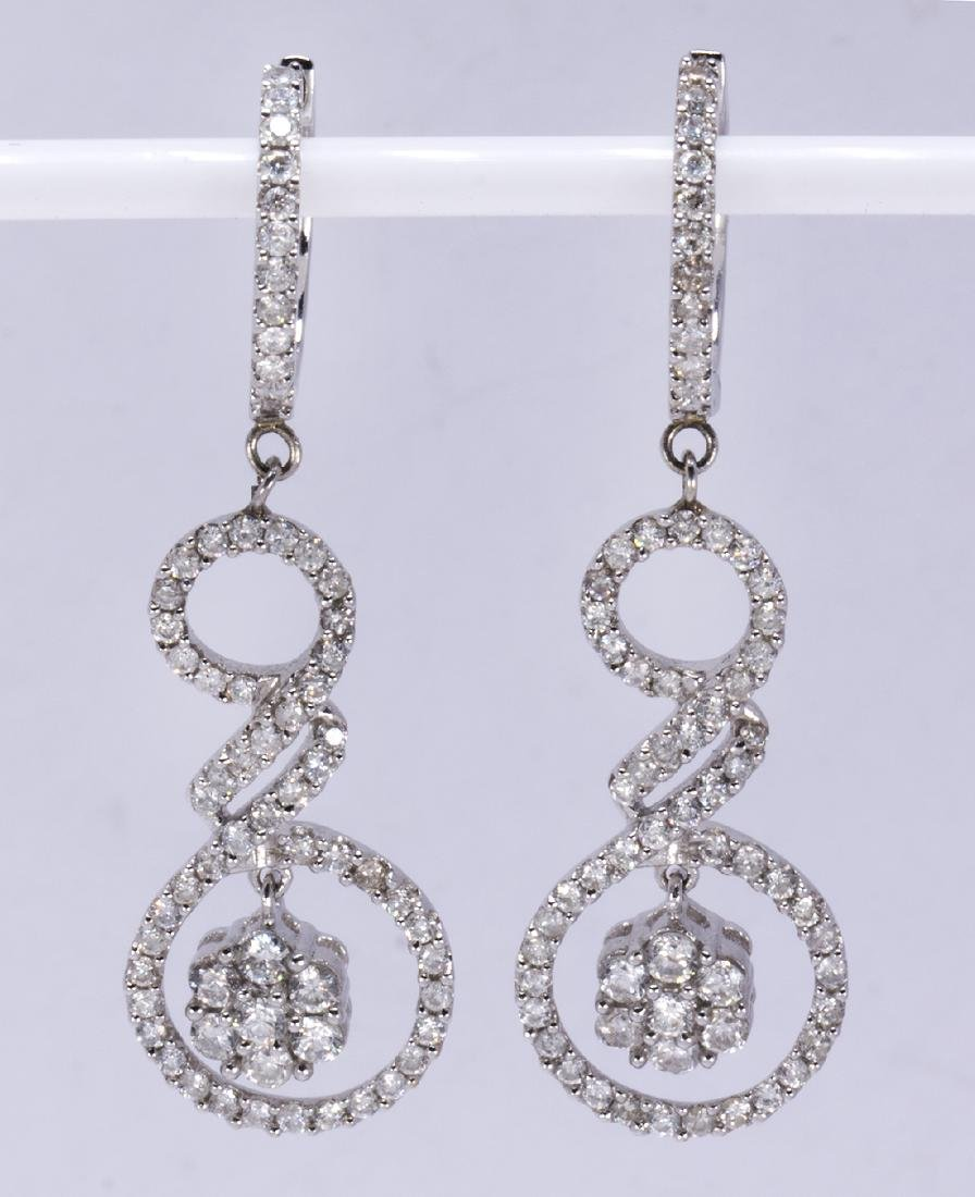 Pair of diamond and 18k white gold earrings
