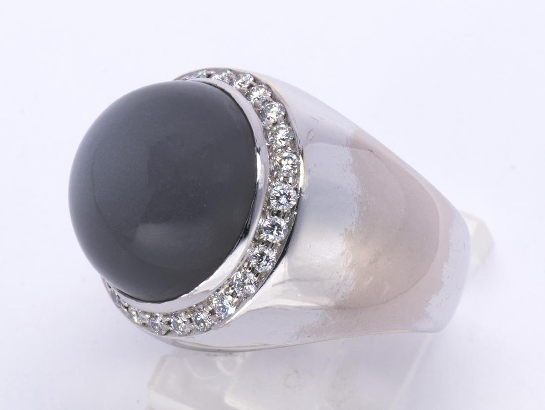 Sapphire, diamond and 18k white gold ring