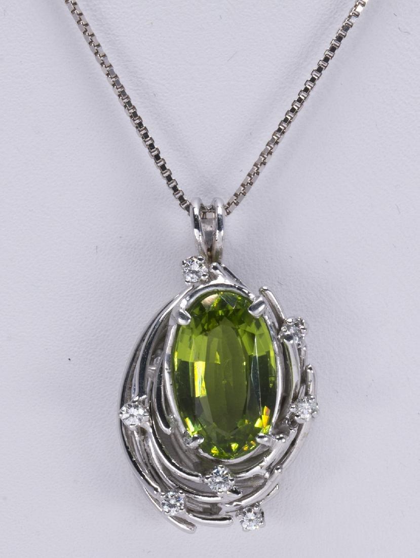 Peridot, diamond and 14k white gold pendant-necklace