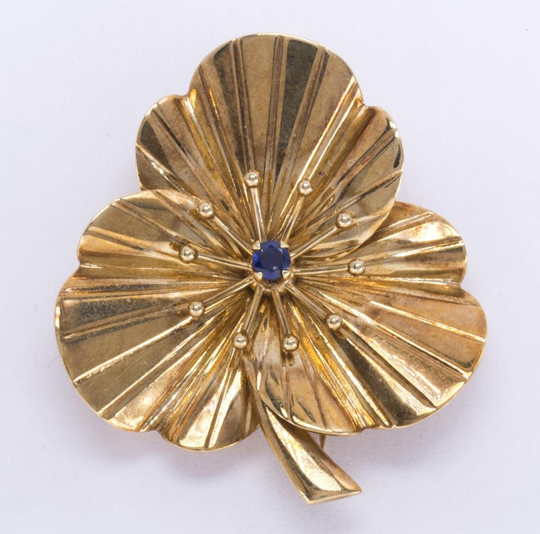 Synthetic sapphire and 14k yellow gold flower brooch