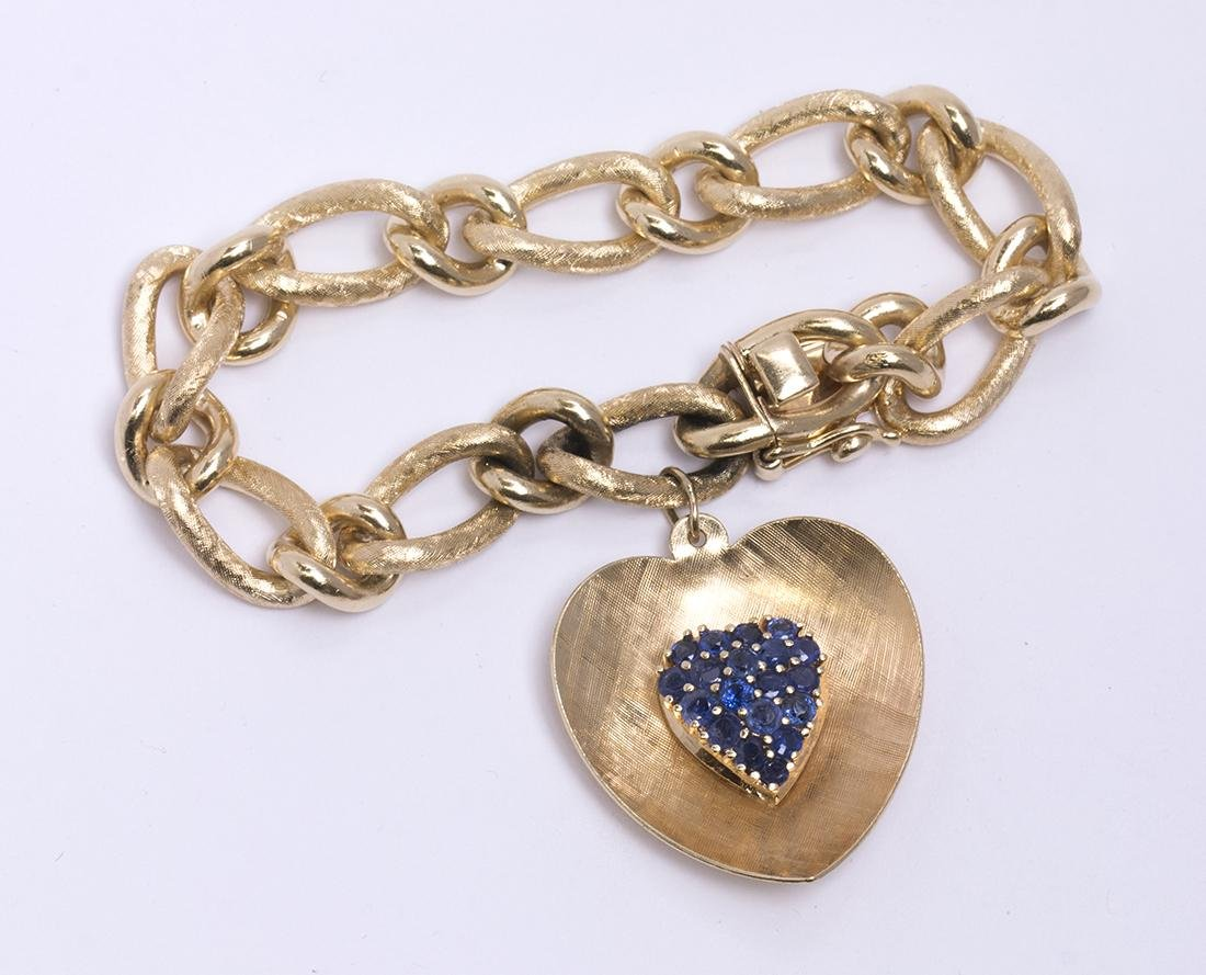 Sapphire and 14k yellow gold charm bracelet