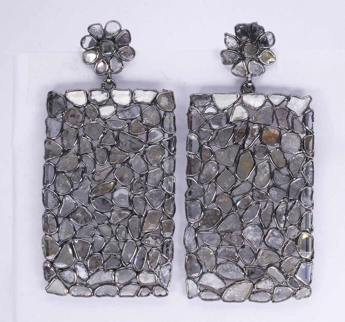 Pair of diamond and silver earrings