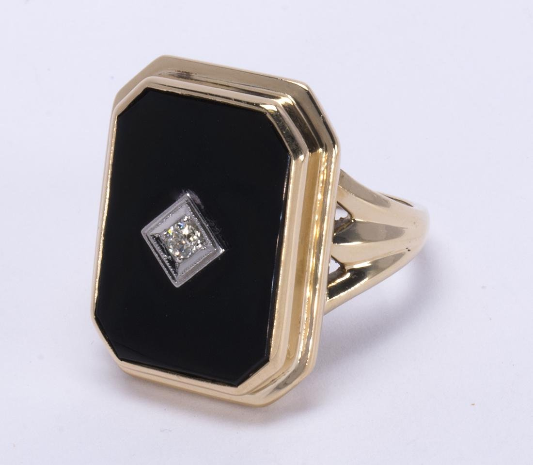 Diamond, black onyx and 14k yellow gold ring
