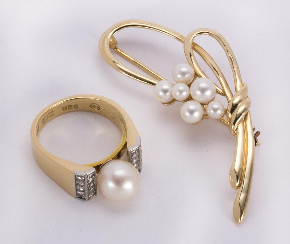 Cultured pearl, diamond, platinum and yellow gold