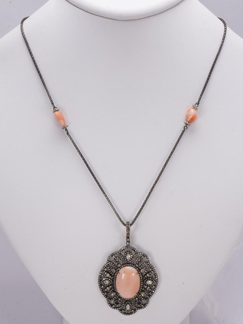 Coral, diamond, 18k yellow gold and blackened silver