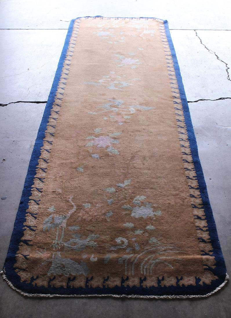 "Chinese rug depicting cranes and flowers, 12'9"" x 3'7"""