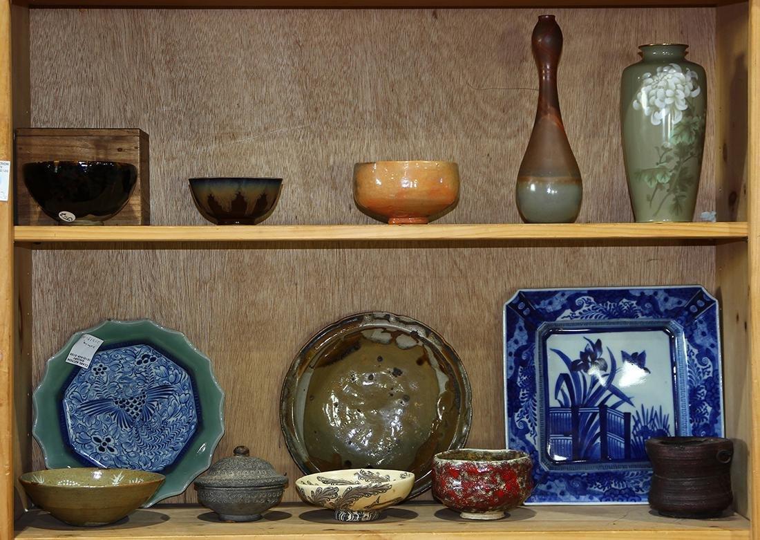 Two Shelves of Japanese Ceramics