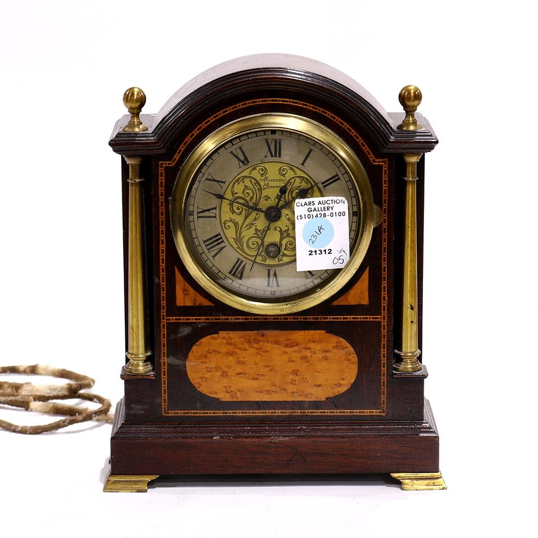 Manning Bowman mantle clock, the rounded stepped