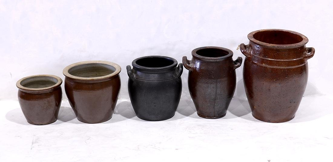 (lot of 5) Redware pottery group, each vessel with a
