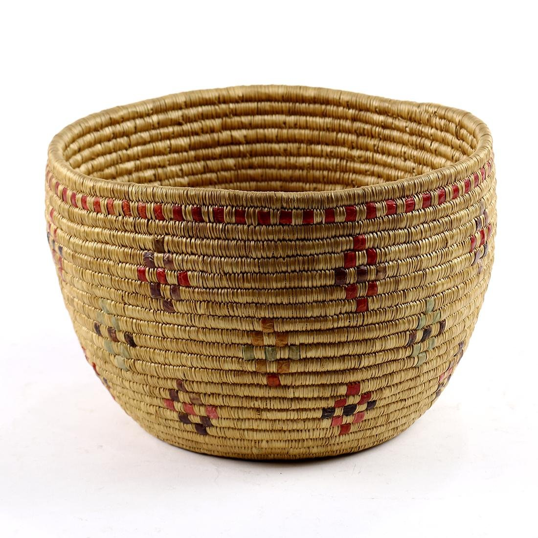 Southwest coiled basket, 20th Century, having dyed