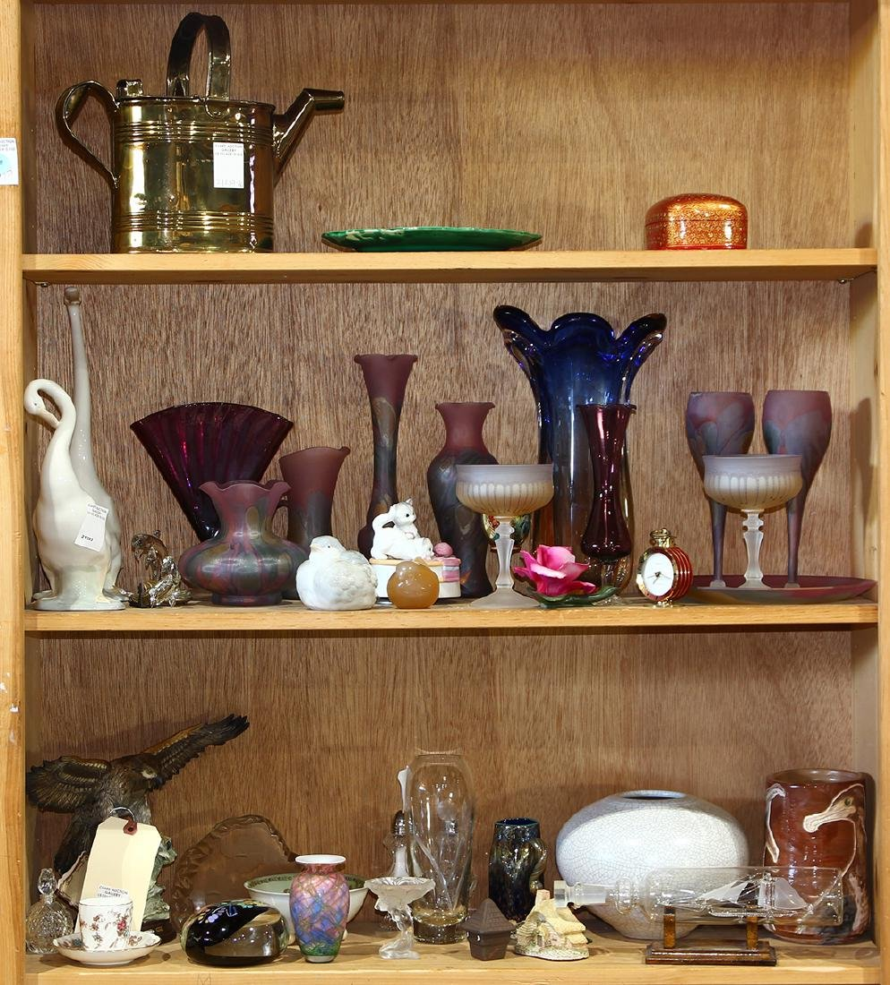 Three shelves of assorted decorative articles