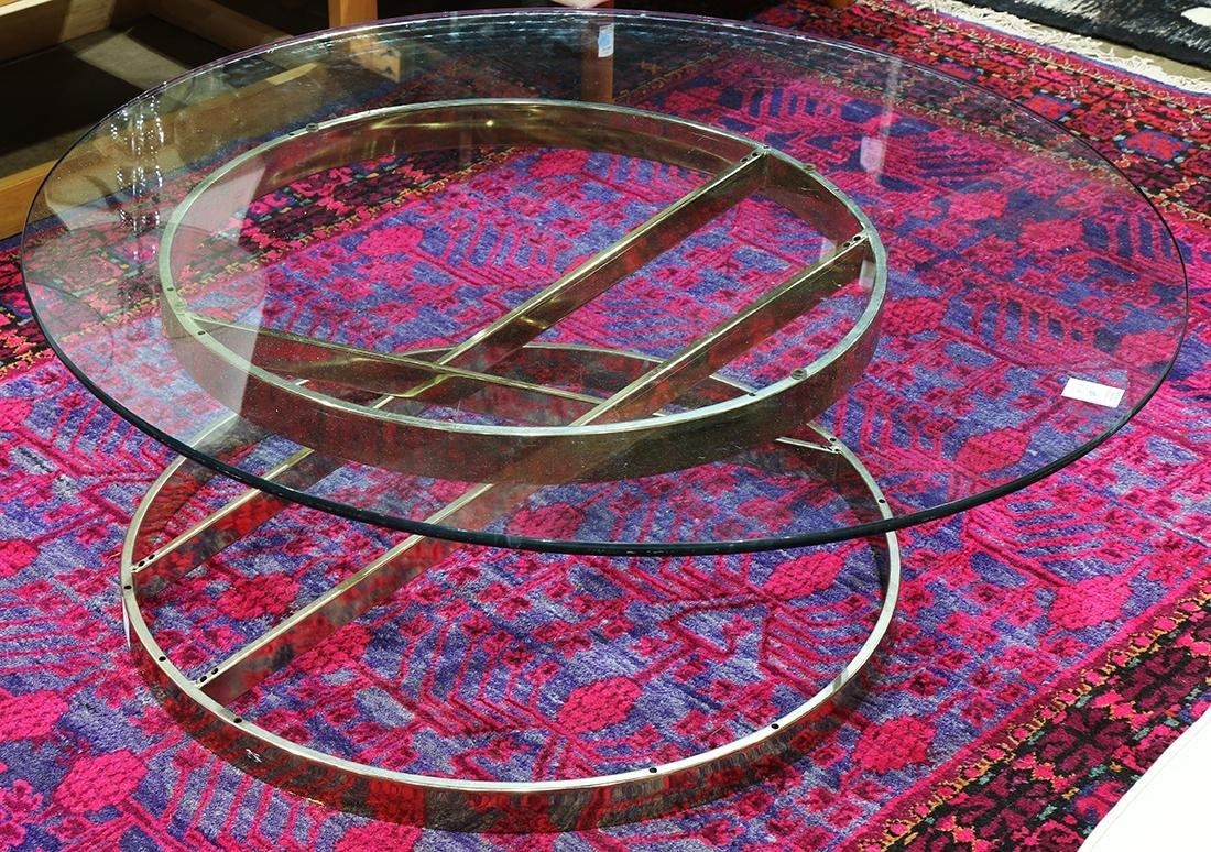 Moderne style coffee table, having a circular glass