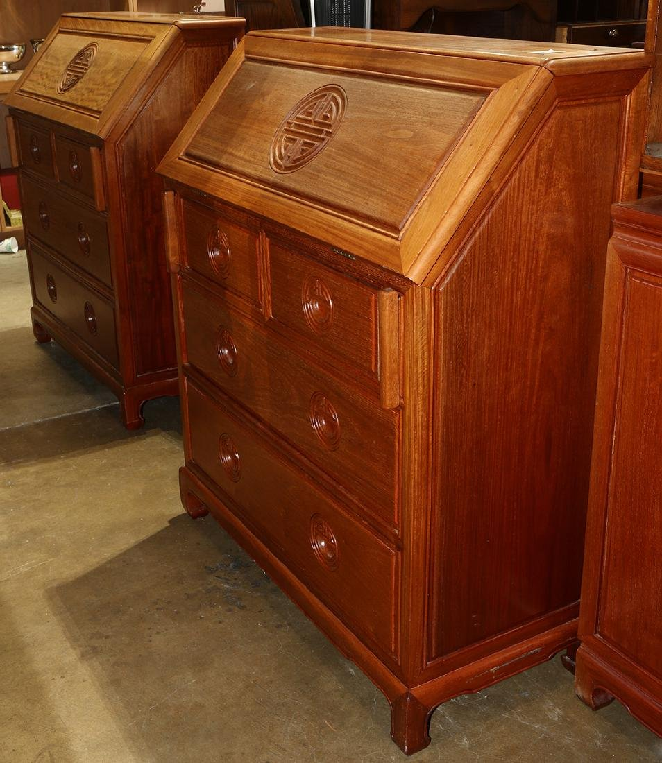 Pair of Chinese desks, each executed in hardwood and