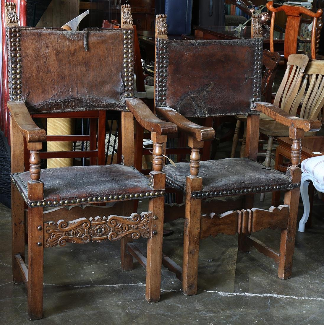 Pair of Spanish Revival armchairs, having carved posts