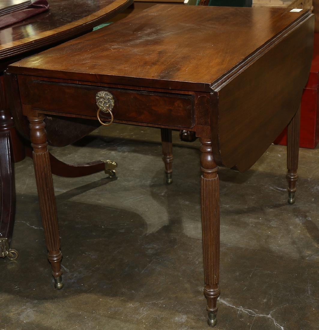 Federal Pembroke table, executed in walnut and rising