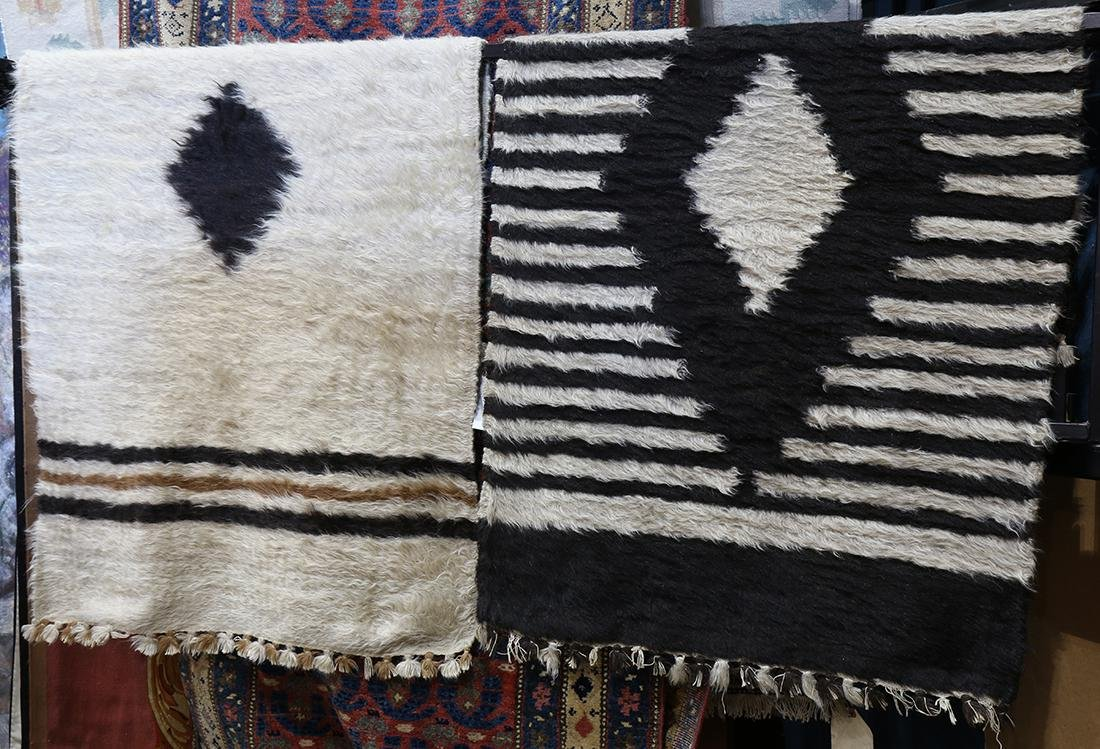 "(lot of 2) Peruvian Alpaca rugs, largest: 3' x 5'5"""