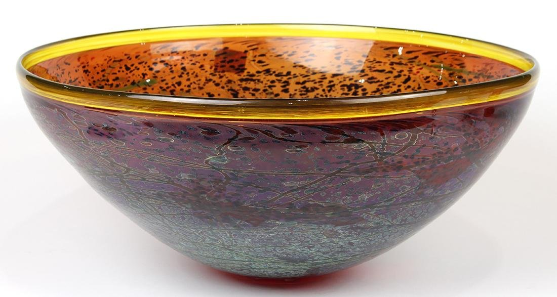 Large art glass bowl, having a yellow rim above the