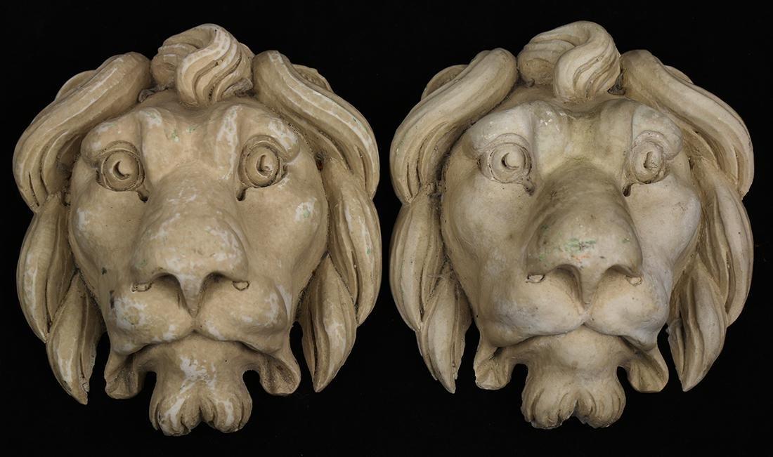 Pair of lionhead architectural elements, 20th Century,