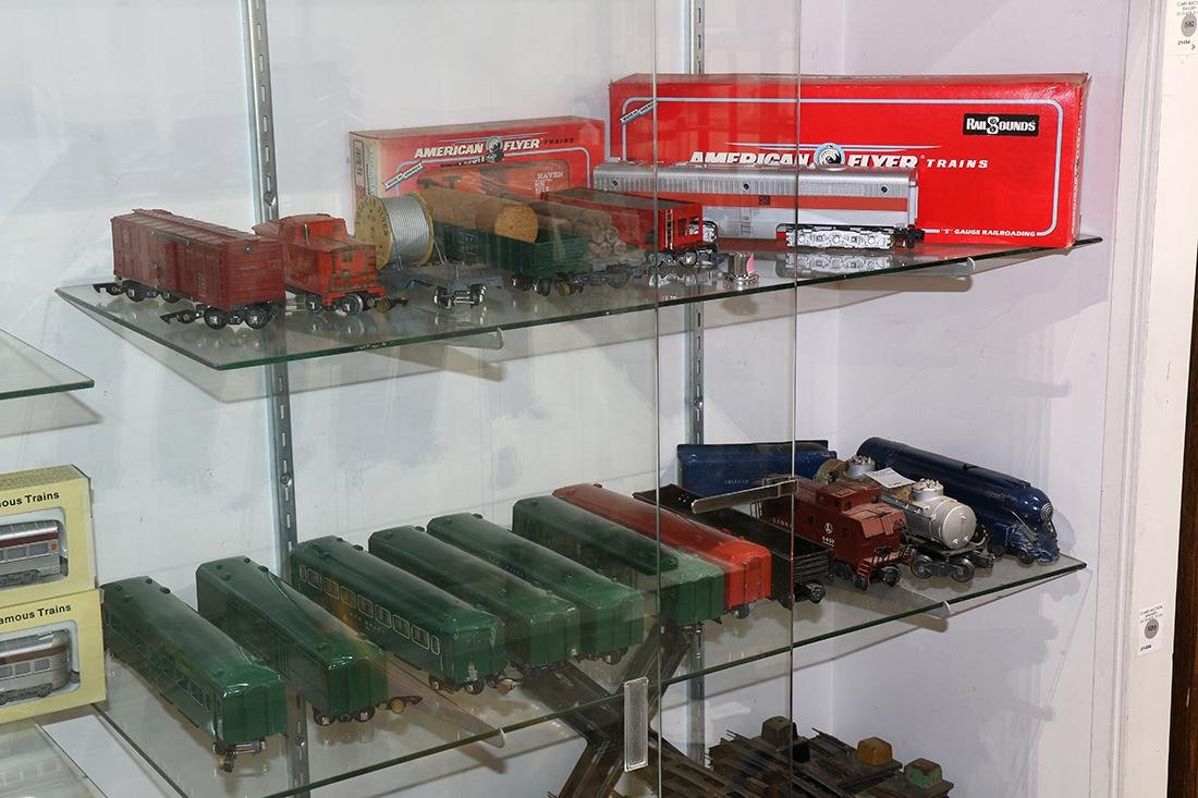 Three shelves of American Flyer trains and accessories,